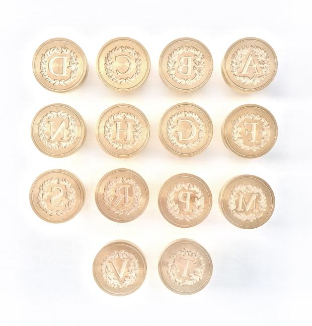 WiriWoods_Sellos-abecedariometal